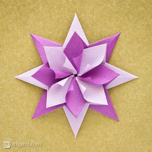 estrella de navidad hecha con papel y la téncnica de origami japones