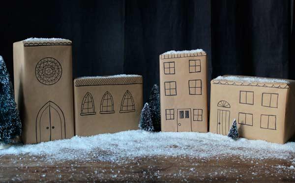 regalos de navidad con papel de regalo decorado en forma de ciudad nevada