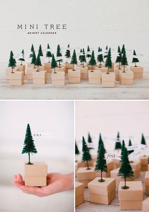 calendario de adviento hecho con cajitas y figuras de pino