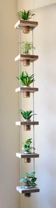 jardín vertical colgante con tarros