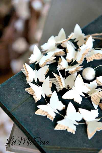 guirnalda de papel con forma de mariposas, ideal para boda vintage