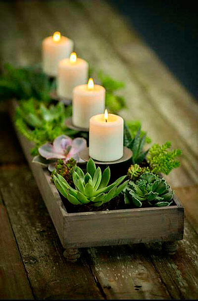 centro de mesa con plantas y velas, ideal para decoración romántica