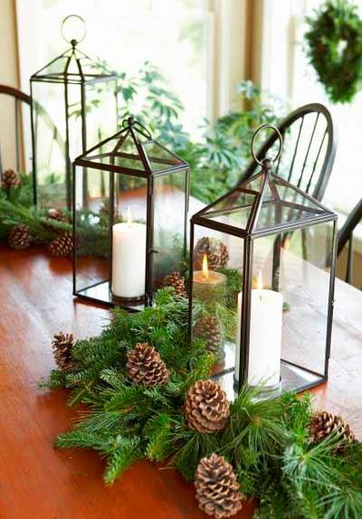 Farolillos para decorar la mesa con hojas de pino y piñas silvestres