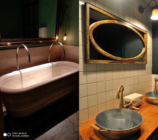 bañera y balde convertidos en lavamanos para el servicio de un restaurante